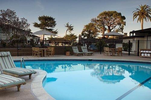 Historic Pool swimming pool building property Resort condominium leisure Villa home mansion backyard blue swimming