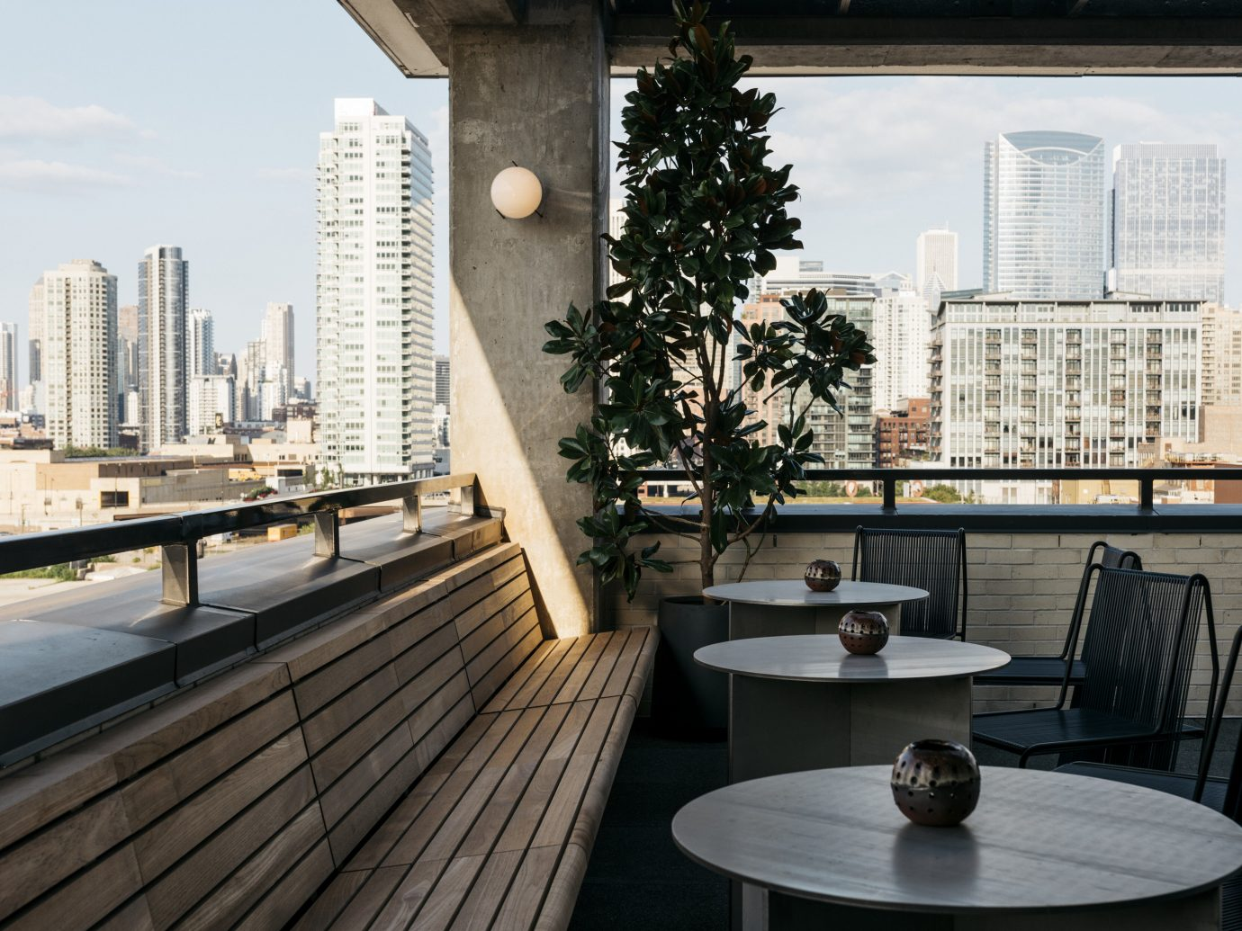 Food + Drink Architecture condominium roof Balcony furniture apartment real estate building window interior design home outdoor structure table Deck penthouse apartment overlooking