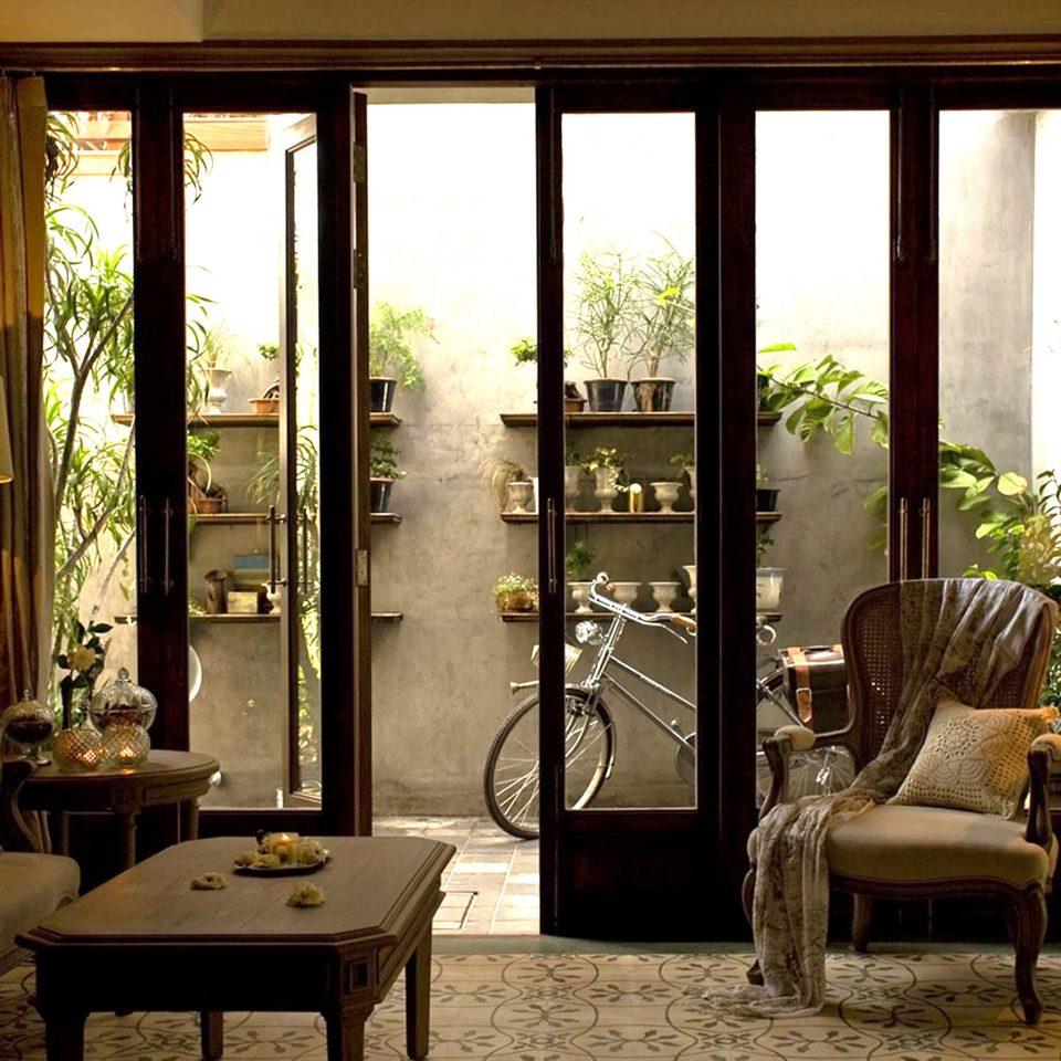 Honeymoon Jungle Lobby Patio Romance Tropical chair property living room home door porch window treatment curtain