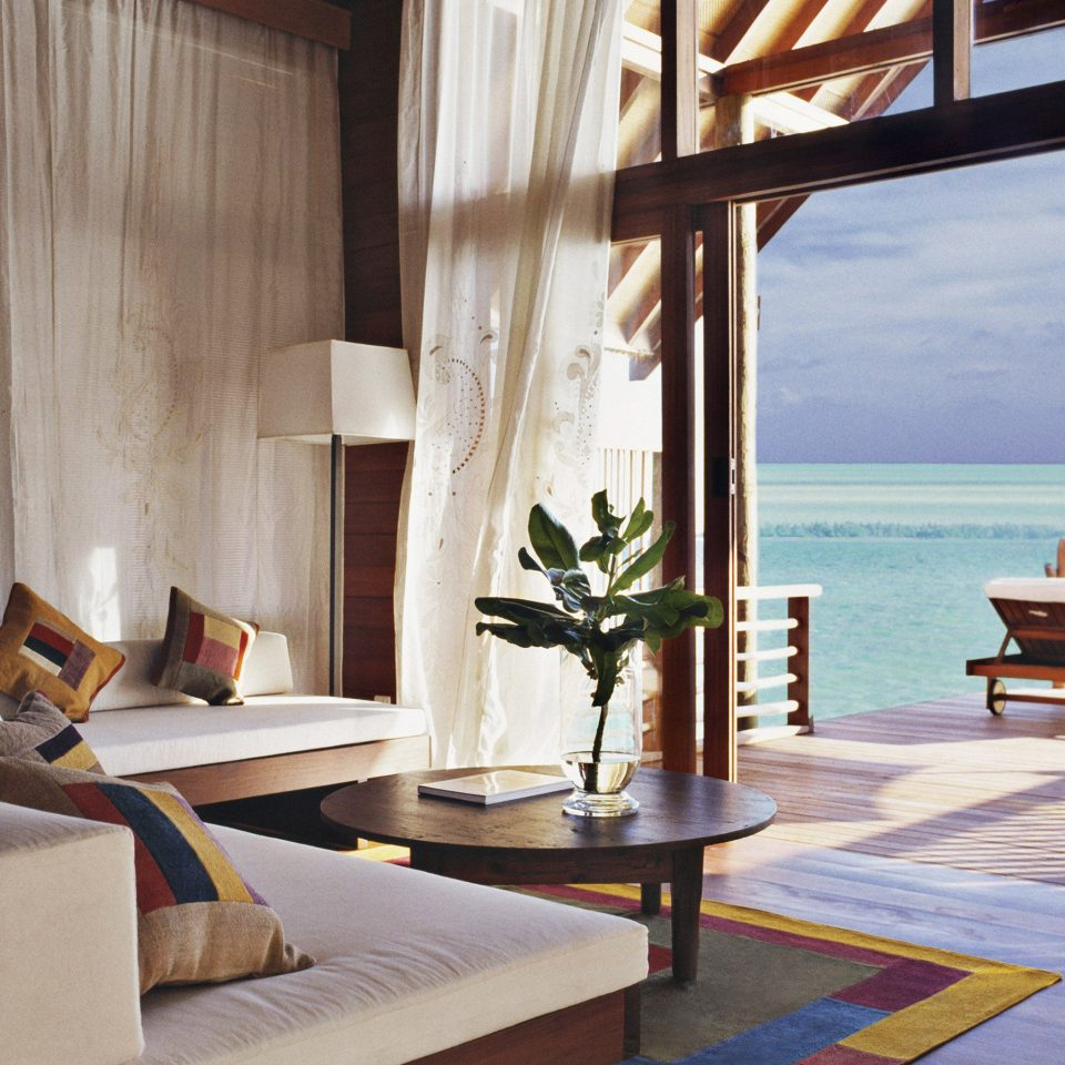 Honeymoon Luxury Overwater Bungalow Romance Romantic Tropical Waterfront house property home living room Villa