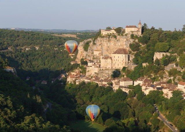 balloon sky tree mountain aircraft grass Hot Air Balloon transport vehicle hill hillside