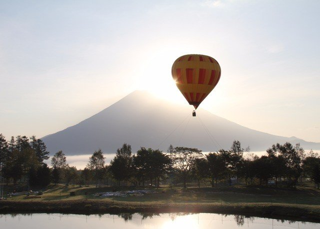 sky aircraft transport grass hot air ballooning balloon Hot Air Balloon vehicle atmosphere of earth Lake day