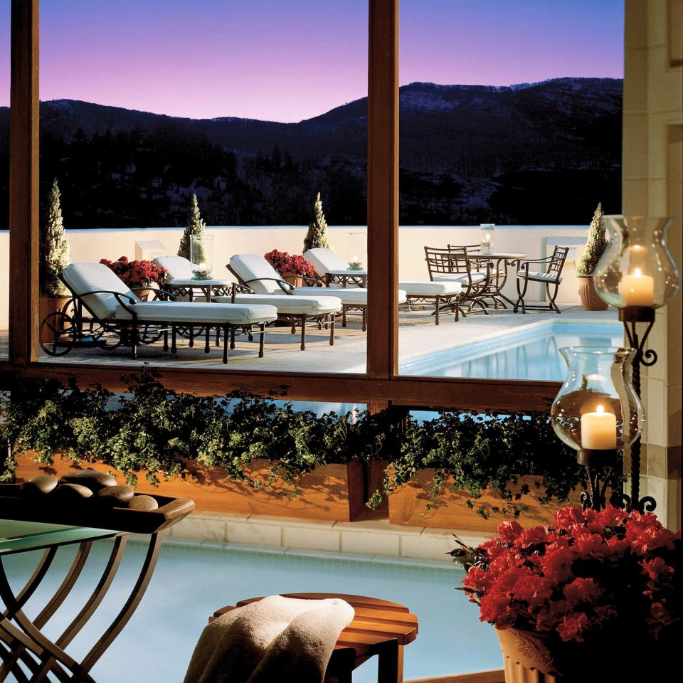 Hot tub Hot tub/Jacuzzi Mountains Pool Resort Scenic views Sunset photograph image chair home restaurant set