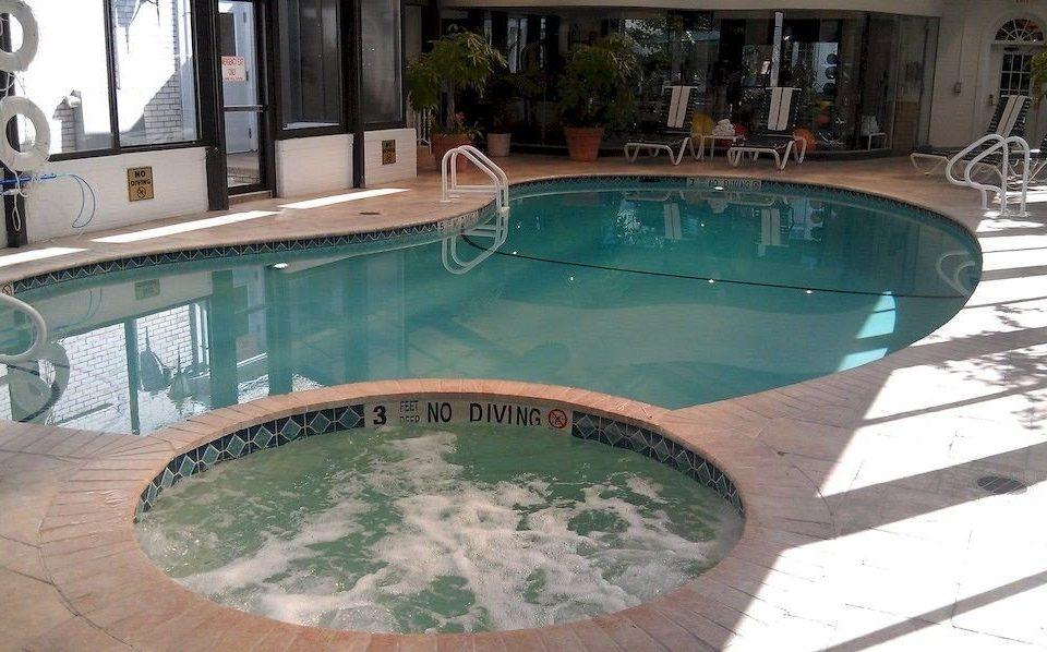 Hot tub/Jacuzzi Pool Romantic ground swimming pool property green jacuzzi reflecting pool backyard Hot tub Villa Resort