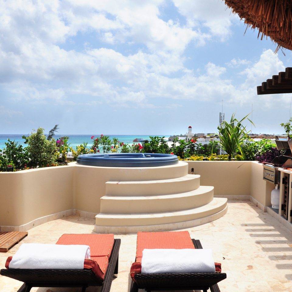 Hot tub Hot tub/Jacuzzi Scenic views Waterfront Wellness sky leisure property Resort swimming pool Villa home hacienda