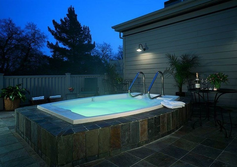 Hot tub/Jacuzzi tree swimming pool property backyard billiard room lighting jacuzzi Villa mansion landscape lighting Hot tub