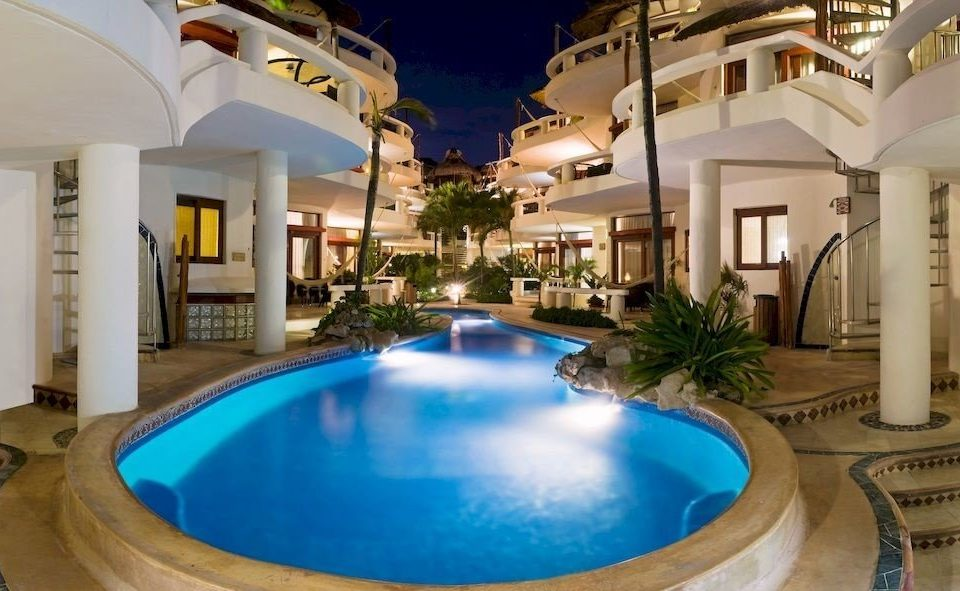 Hot tub/Jacuzzi Lounge Luxury Modern Pool Tropical swimming pool property building Resort mansion Villa condominium home blue jacuzzi plant hacienda tub