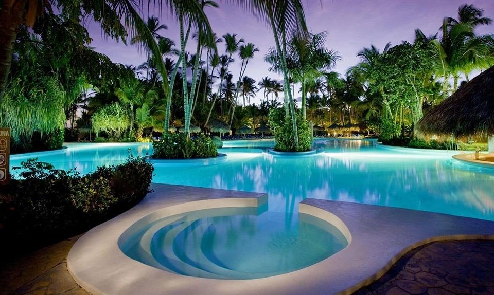 Hot tub/Jacuzzi Lounge Luxury Modern Pool Tropical tree Resort palm swimming pool leisure Nature reflecting pool backyard blue plant lined colorful swimming