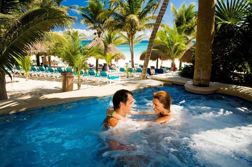 Hot tub/Jacuzzi Lounge Luxury Pool tree water leisure swimming pool Water park Resort caribbean water sport resort town amusement park tropics palm swimming
