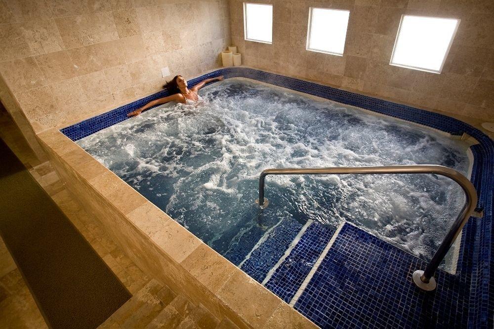 Hot tub/Jacuzzi Lounge Luxury Pool bathtub swimming pool vessel bathroom plumbing fixture jacuzzi flooring daylighting tile