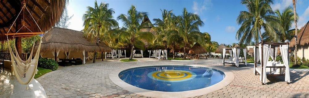 Hot tub/Jacuzzi Lounge Luxury Pool tree sky ground Resort palm leisure property swimming pool hacienda Villa Water park plant Village empty