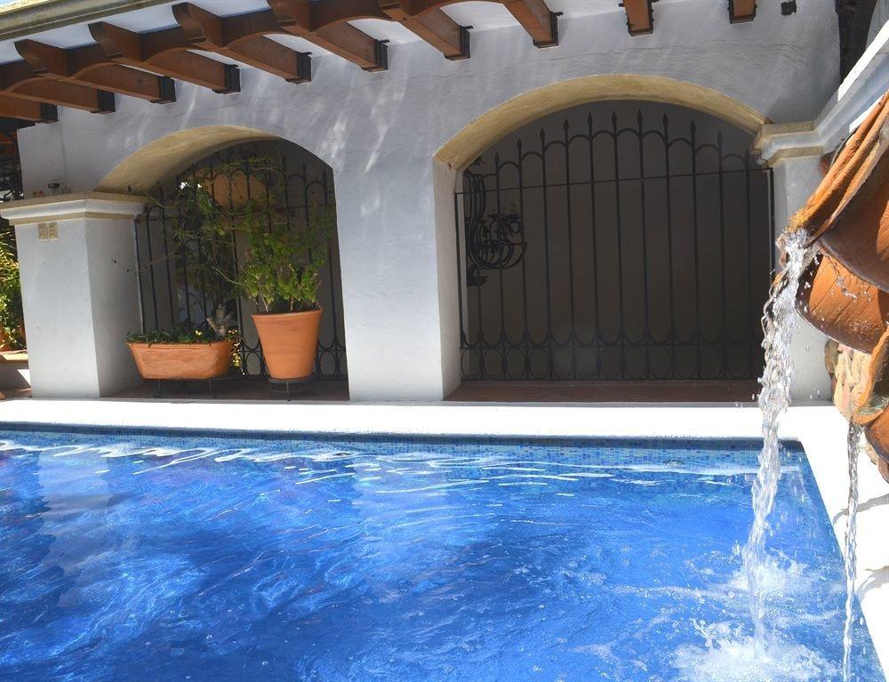 Outdoors Pool Wellness swimming pool building property leisure jacuzzi Villa blue backyard mansion Hot tub Resort