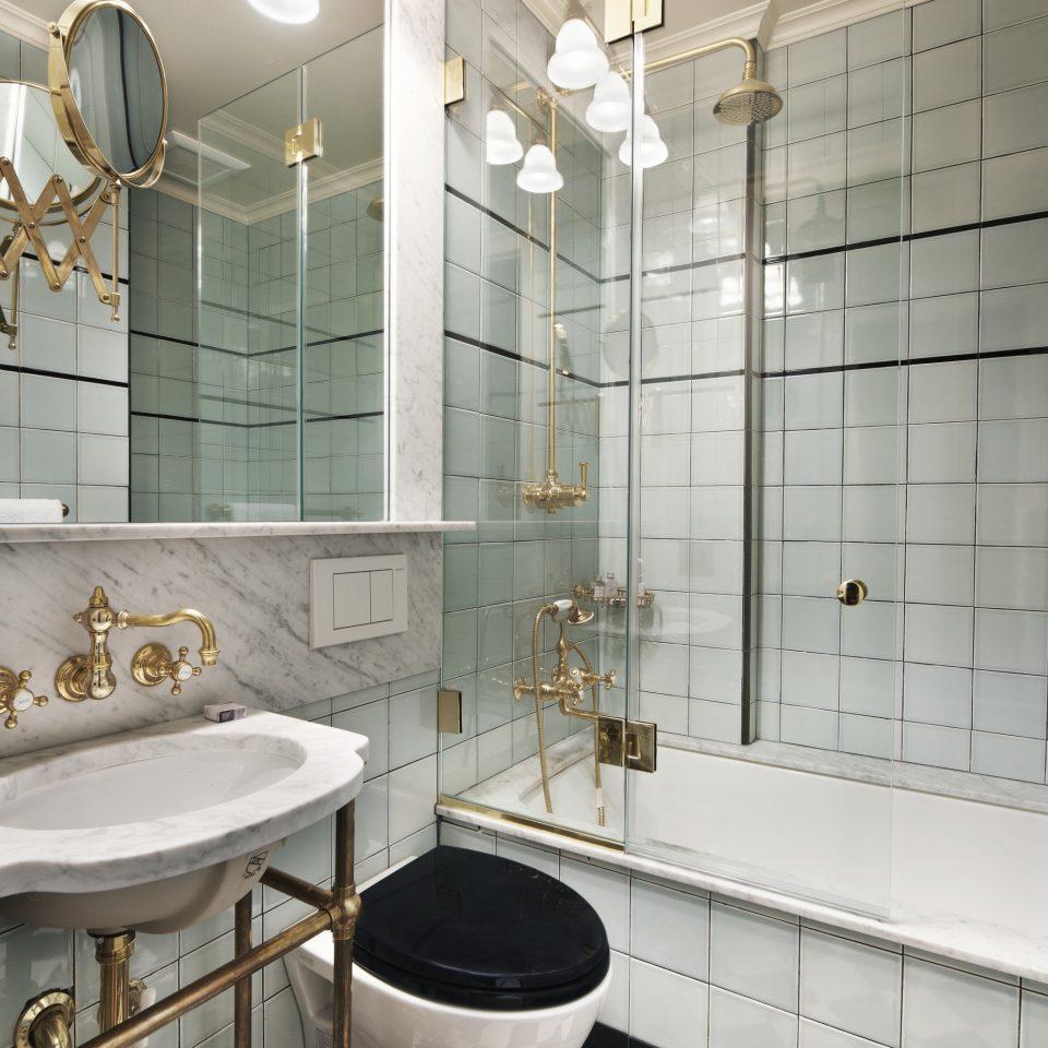 Hotels bathroom sink tile flooring lighting plumbing fixture toilet tiled