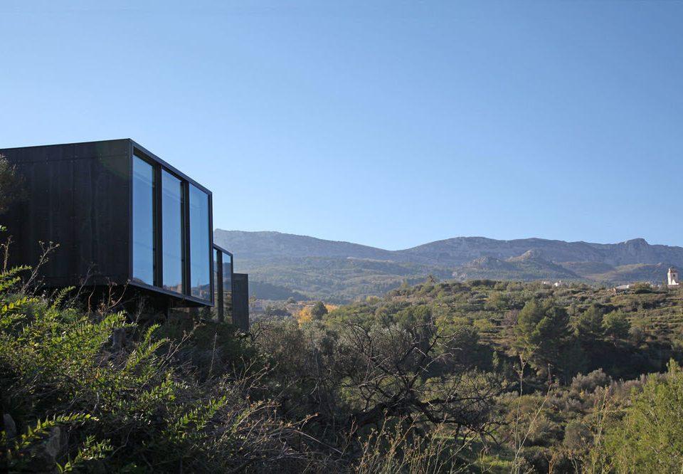 Hotels sky grass mountain mountainous landforms building hill rural area landscape hillside lush