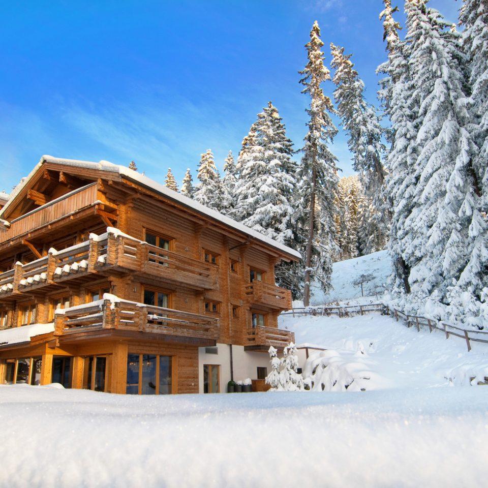 Hotels Luxury Travel Mountains + Skiing snow tree sky Winter weather season geological phenomenon Resort Nature mountain mountain range