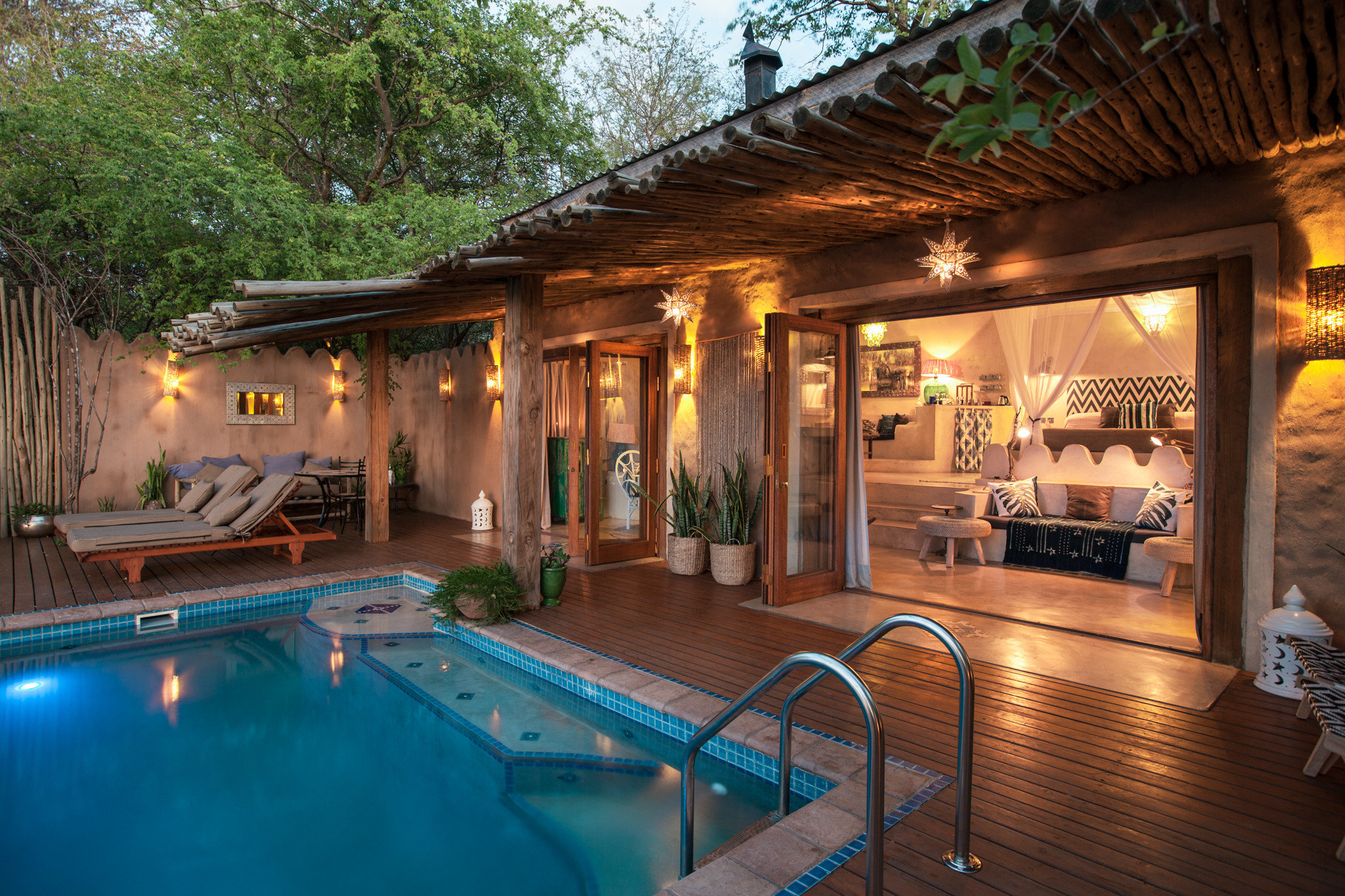 Hotels Safaris property swimming pool building home Resort leisure Villa backyard outdoor structure Patio house cottage amenity resort town