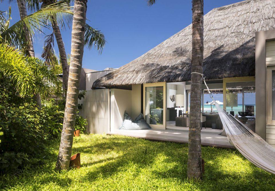 Hotels tree grass sky property house home Resort Villa cottage Village