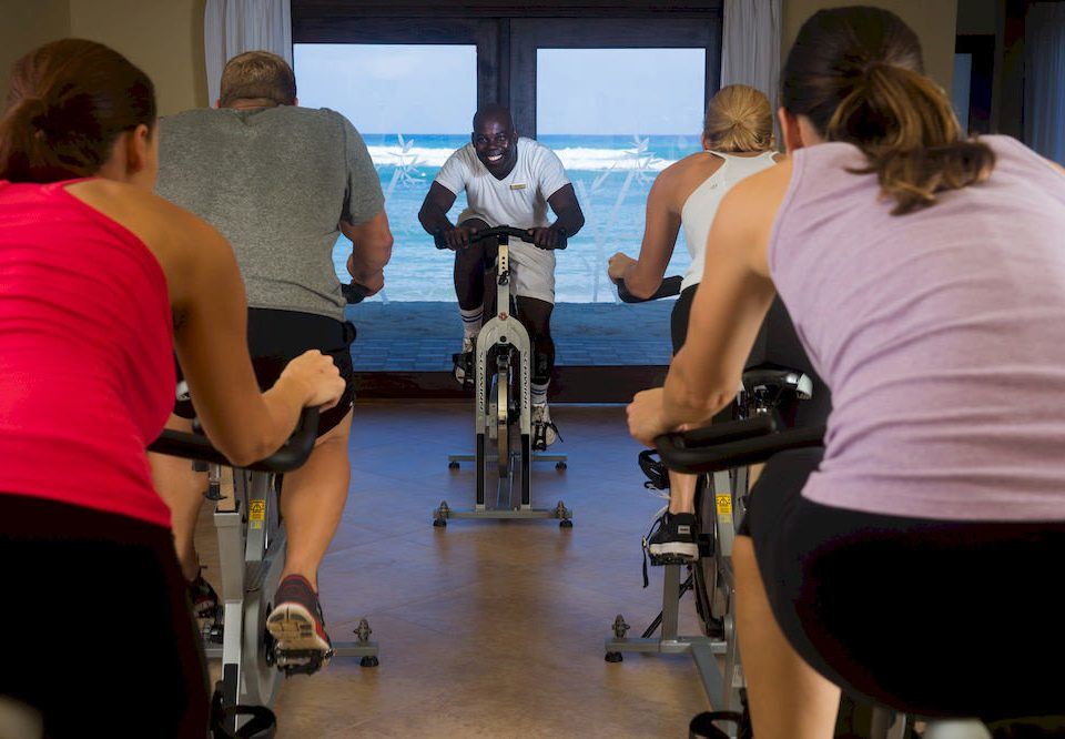 human action indoor cycling structure sports sport venue muscle physical fitness physical exercise weight training