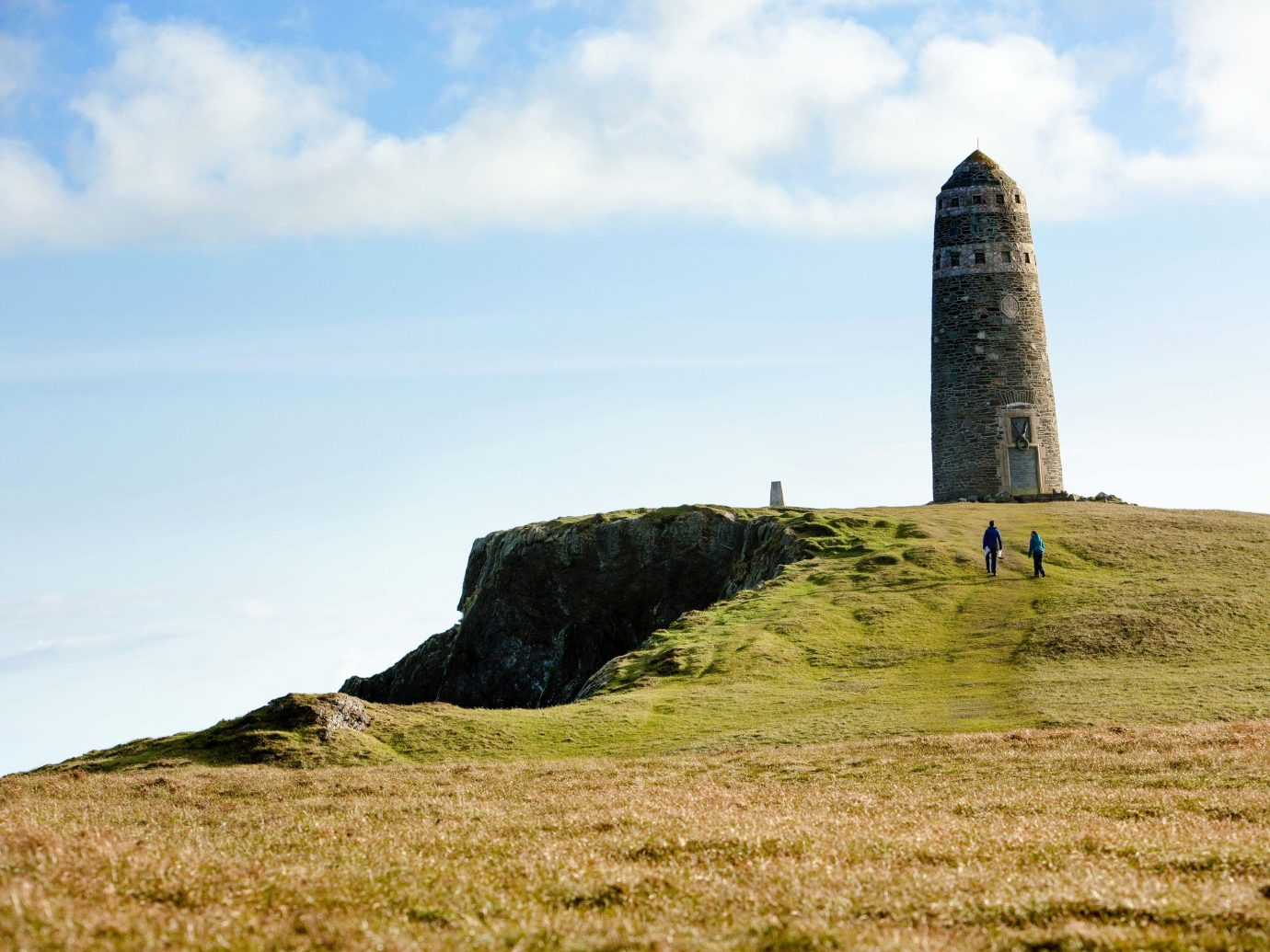 Trip Ideas grass sky outdoor field building promontory grassy megalith tower terrain hill Coast grassland lighthouse Sea cloud beacon headland rock hillside lush day