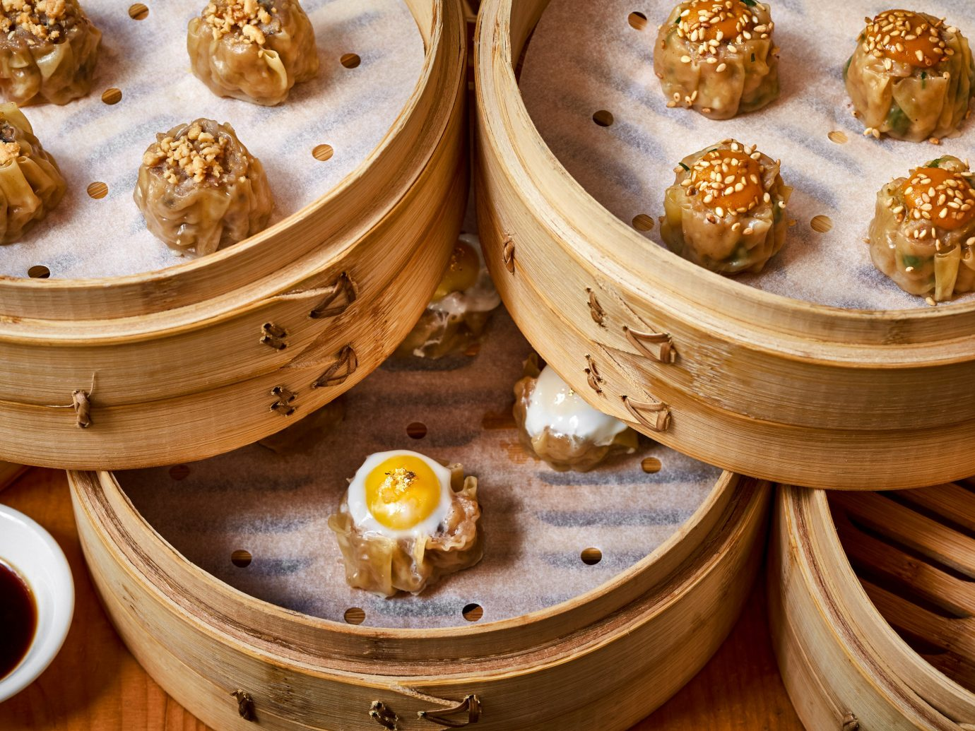 Food + Drink dim sum food dish cuisine chinese food dim sim xiaolongbao finger food asian food wooden mongolian food baozi commodity baking several