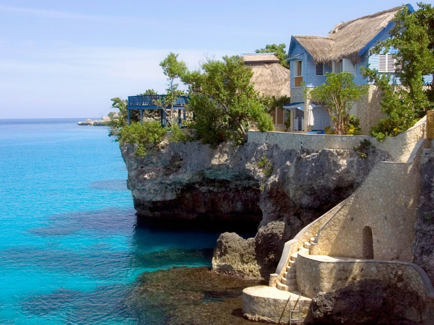 Hotels water outdoor sky house rock landform geographical feature Coast Sea vacation bay Nature tourism terrain Island cove cliff stone cape Beach Resort