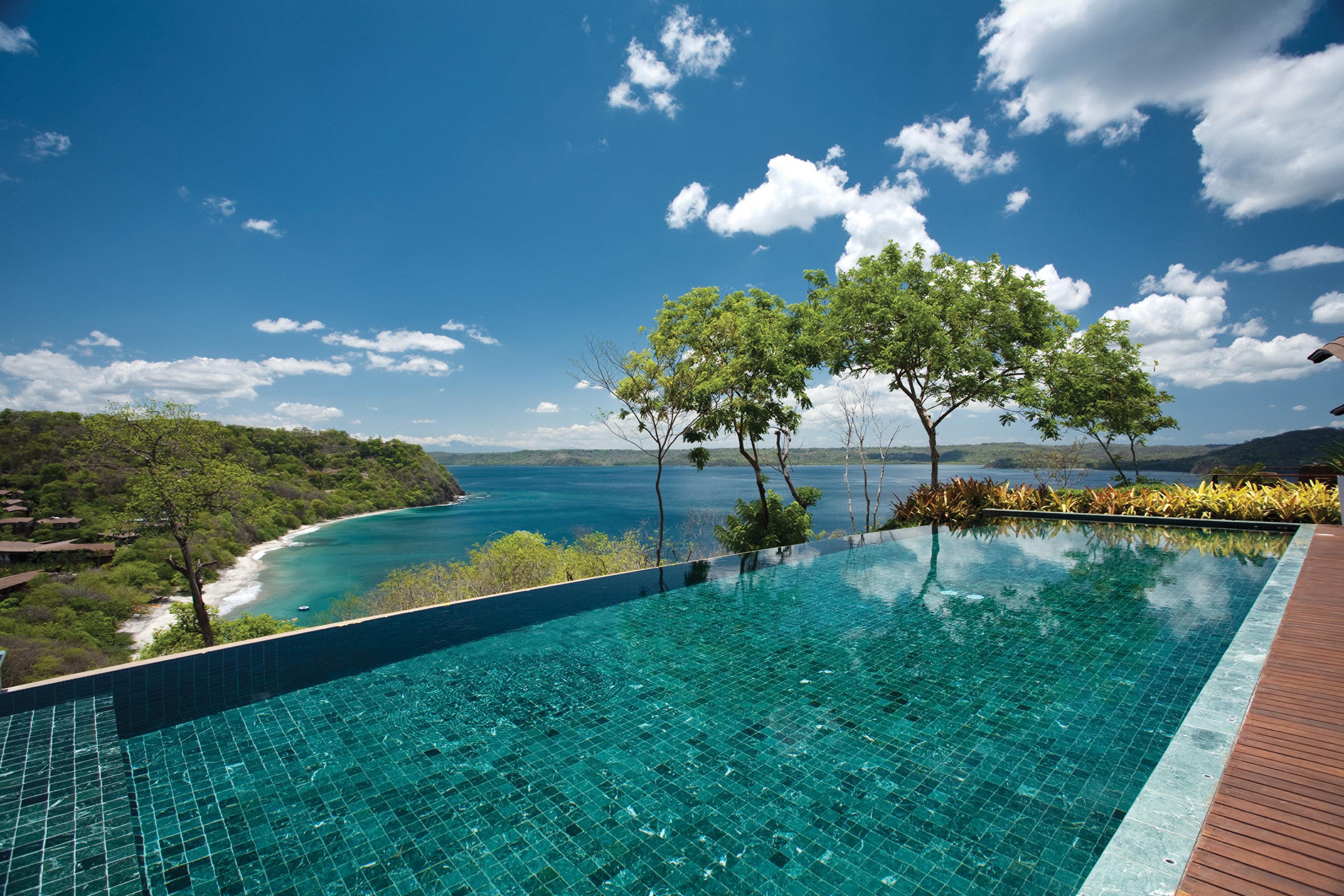 Hotels Living Lounge Luxury Modern Pool Scenic views Trip Ideas sky outdoor swimming pool Sea vacation estate Ocean caribbean Lagoon bay Resort day