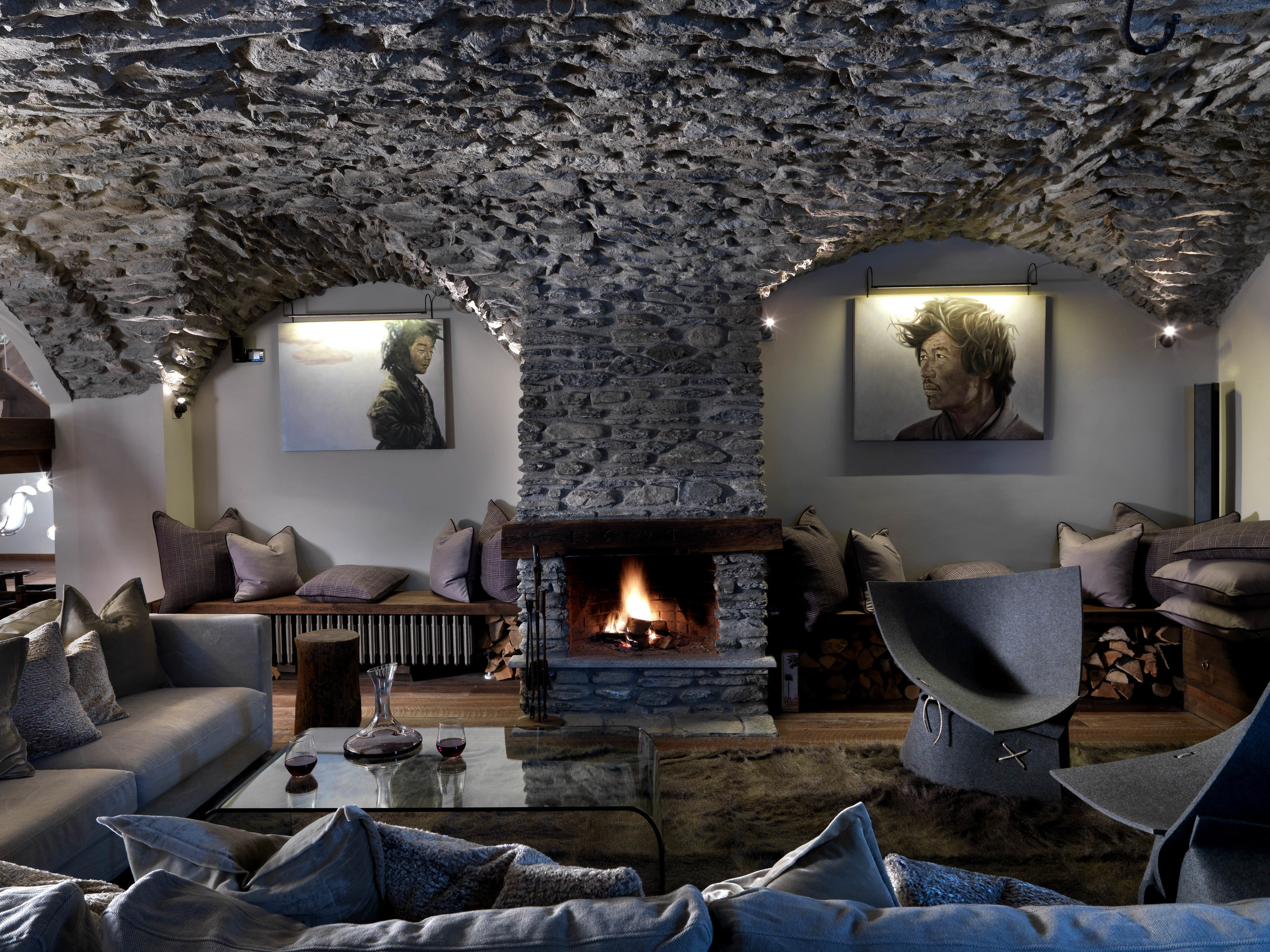 Hotels Luxury Travel Mountains + Skiing Living indoor wall Fireplace room fire living room property home house hearth stone estate interior design cottage lighting furniture Design area