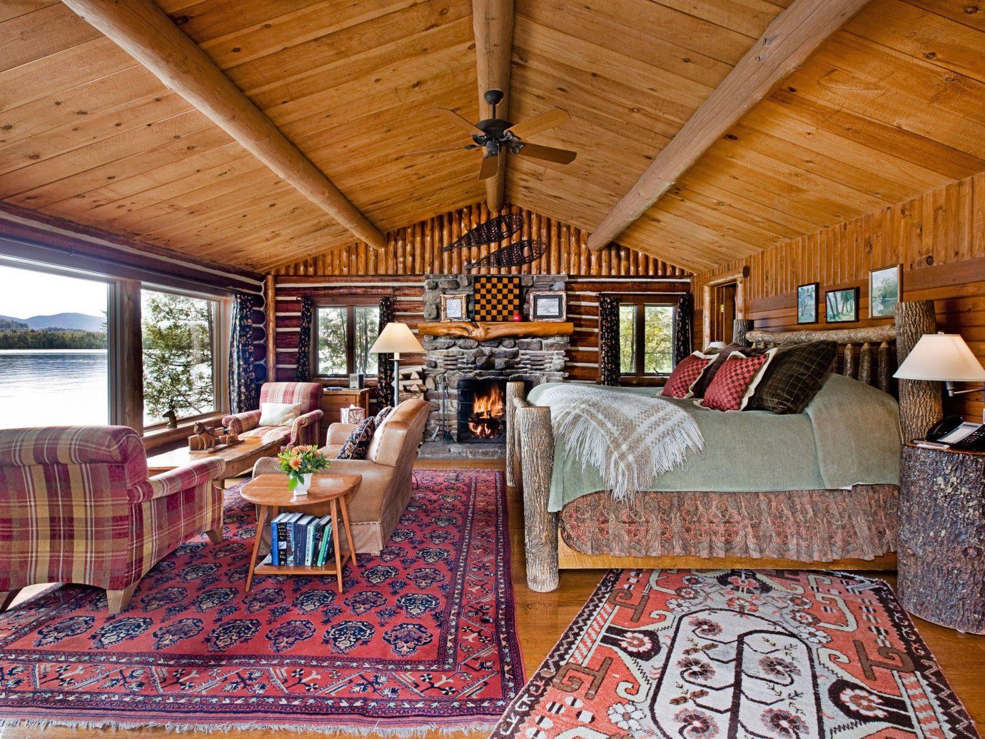 Hotels indoor floor room Living ceiling property log cabin estate cottage home Resort rug living room interior design real estate furniture wood
