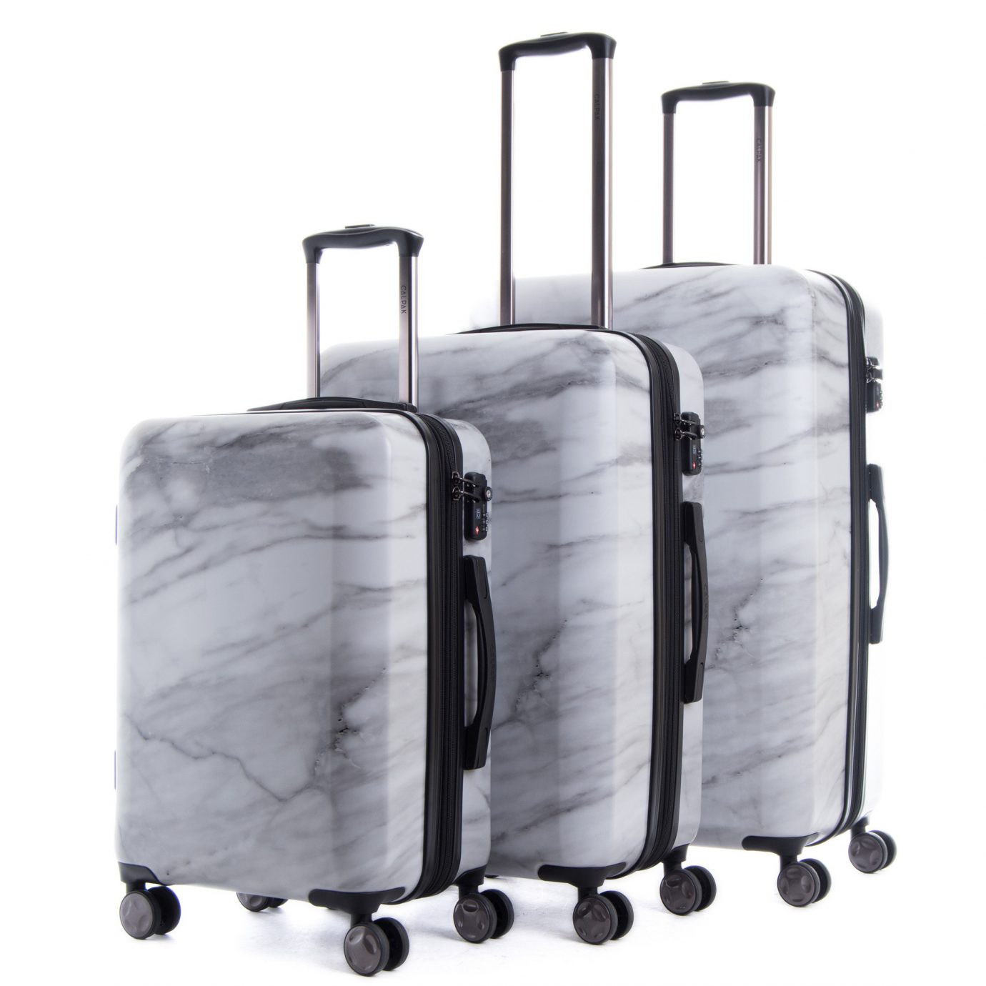 Gift Guides Packing Tips Style + Design Travel Shop luggage suitcase hand luggage indoor product bag handcart different stack
