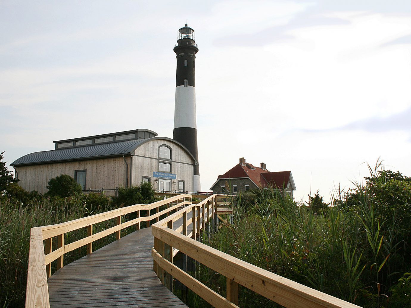 boardwalk Buildings Fog Greenery isolation lighthouse remote Scenic views Trip Ideas view outdoor sky tree building tower wooden waterway Coast walkway stone