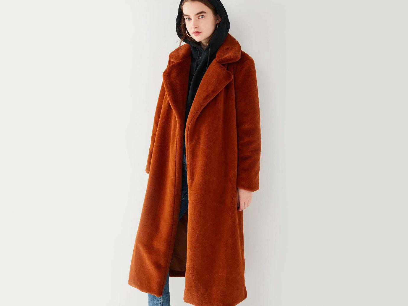 Style + Design Travel Shop fur clothing coat fur wearing hood overcoat jacket neck fashion model dressed orange clothing