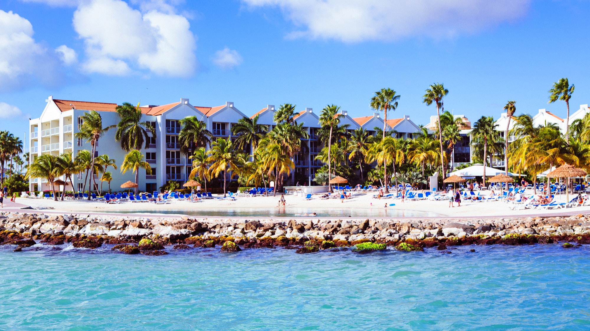 Architecture Aruba Beachfront Buildings Exterior Grounds Hotels sky outdoor water Beach leisure Resort vacation Sea caribbean swimming pool Water park bay amusement park Lagoon Harbor Island park lined swimming colorful sandy
