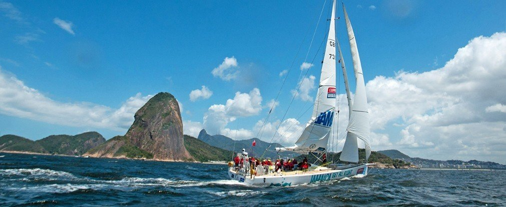 Outdoors + Adventure water outdoor sky Boat mountain watercraft transport sailing sail dinghy sailing sailboat vehicle sailboat racing windsports sports sailing vessel sailing ship yacht racing Sea boating keelboat Lake yacht day