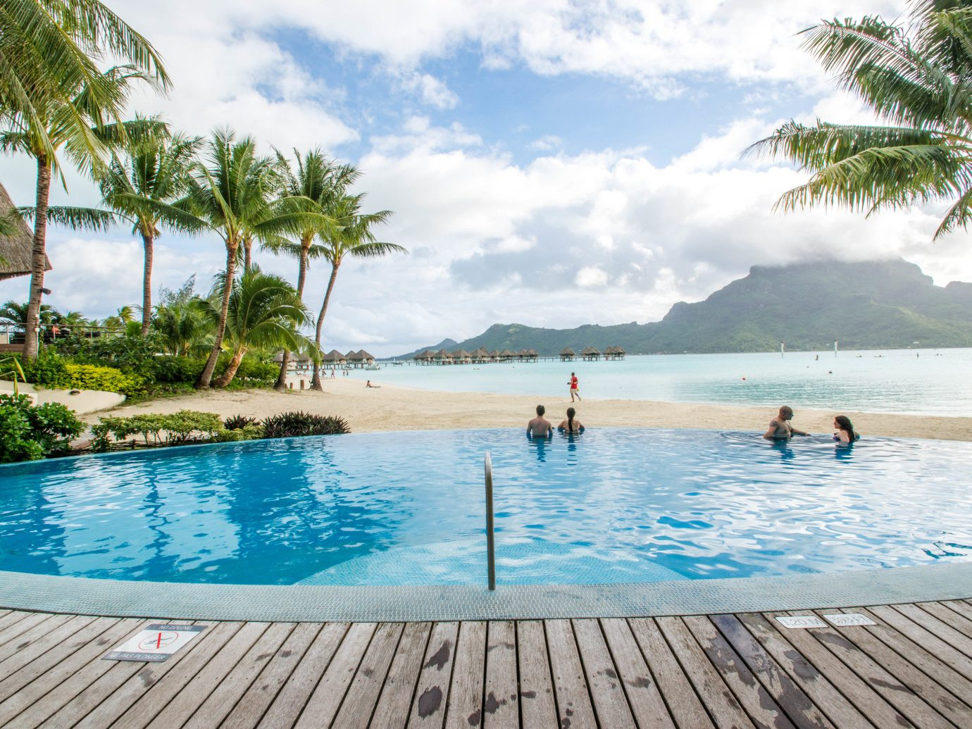 Hotels water outdoor sky tree Pool Beach swimming swimming pool leisure vacation palm Sea caribbean Resort Ocean Lagoon arecales bay estate Lake tropics blue shore sandy