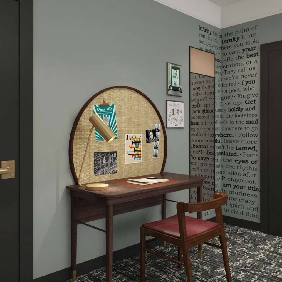 Desk with pictures hanging above it