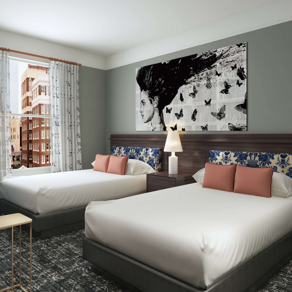 Double bed room with abstract painting above