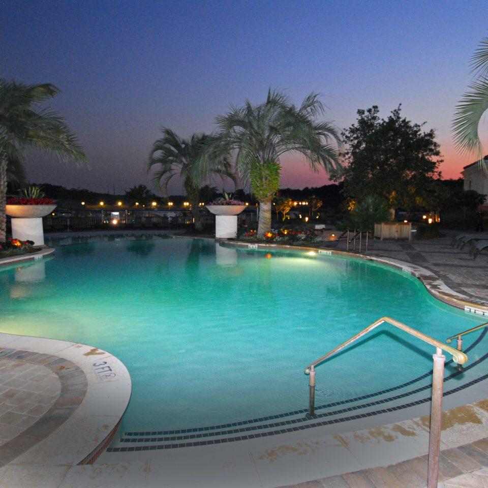 Inn Lounge Patio Pool Resort Trip Ideas water swimming pool property leisure Villa resort town condominium backyard reflecting pool mansion lined