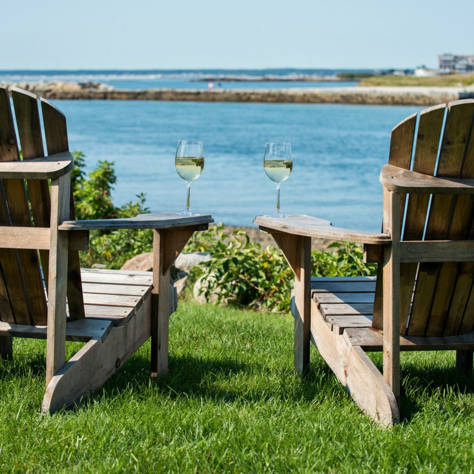 Inn Lounge Waterfront grass sky chair leisure seat overlooking backyard lawn cottage set day