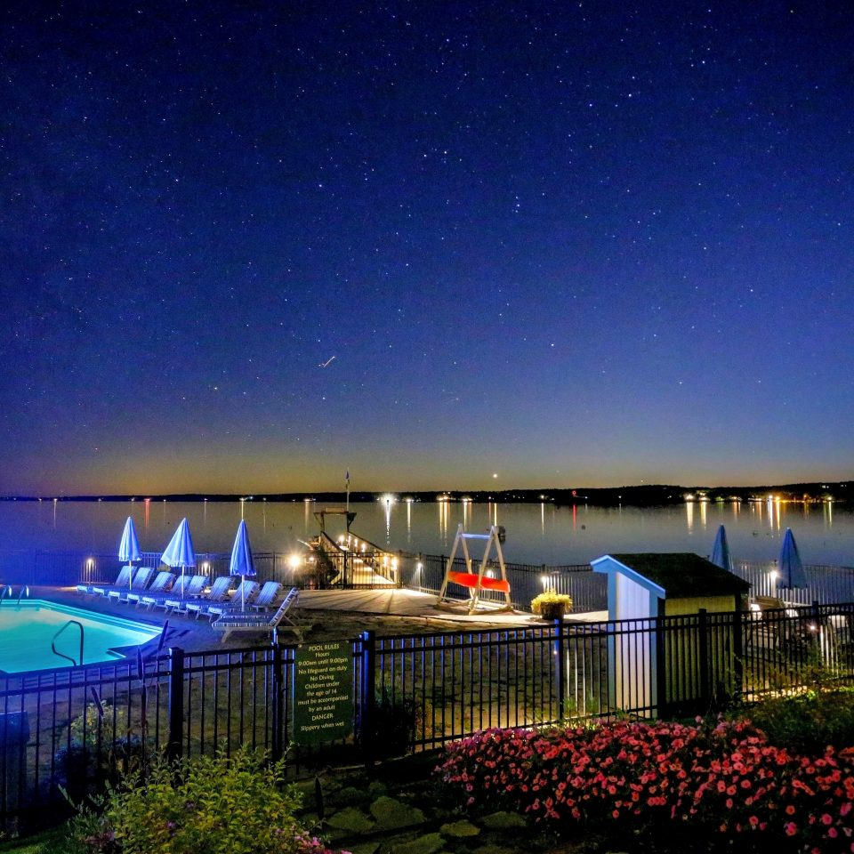 Inn Ocean Patio Pool Resort Terrace Waterfront sky night light lighting swimming pool landscape lighting blue Night Sky
