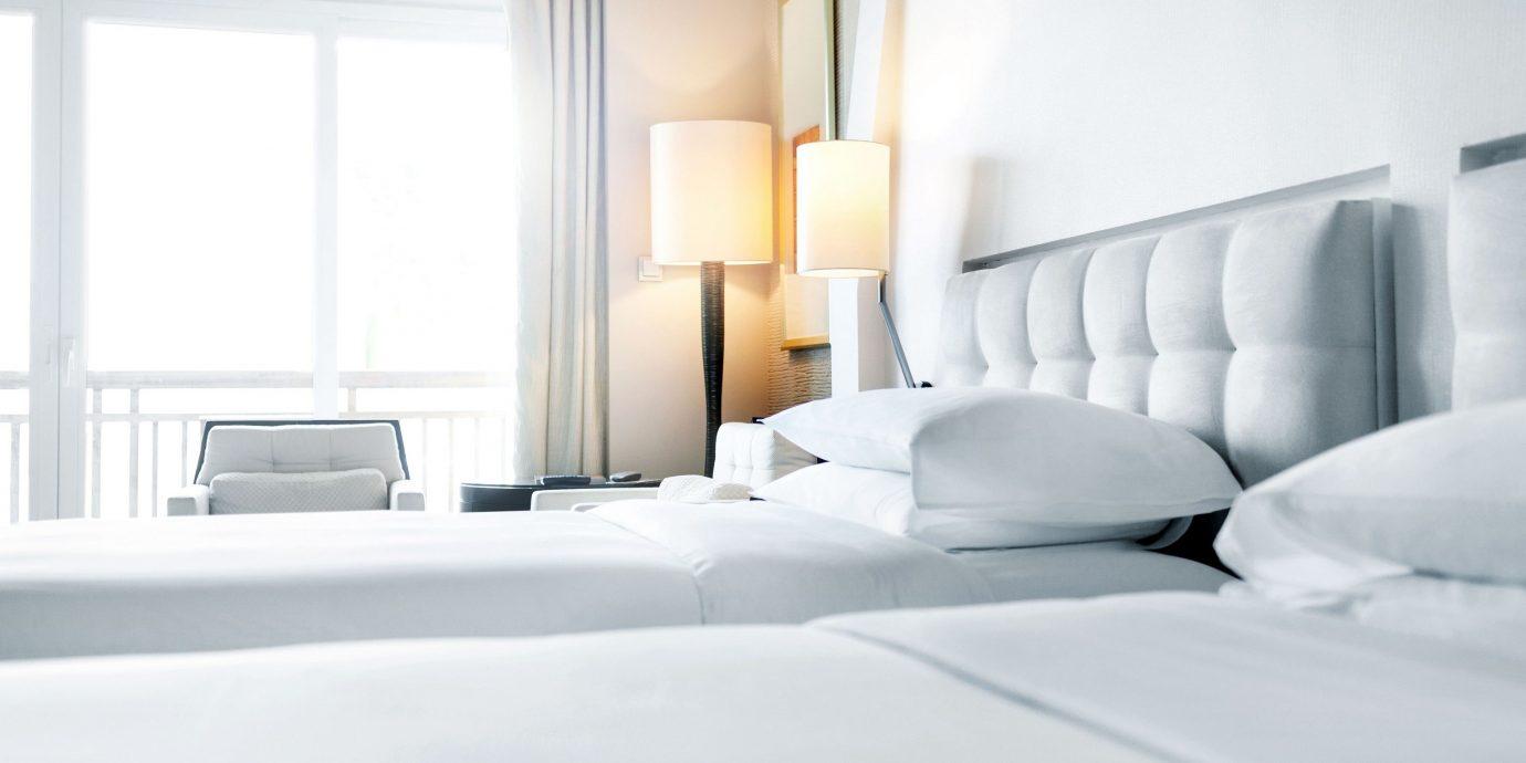 Travel Tips indoor bed wall window room property white hotel Bedroom interior design floor Suite home furniture Design apartment real estate