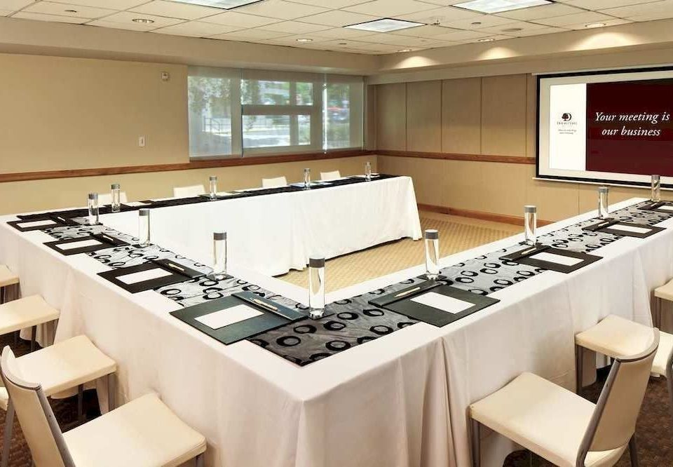 Kitchen classroom conference hall white counter auditorium function hall restaurant appliance Island