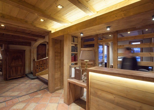 building Kitchen property log cabin hardwood home cottage cabinetry recreation room appliance Island