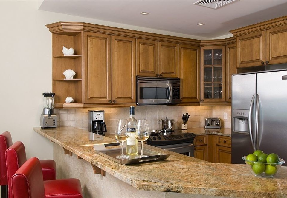 cabinet Kitchen property countertop cabinetry home hardwood wooden living room cuisine classique counter appliance mansion material Island kitchen appliance