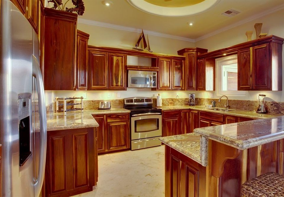 cabinet Kitchen appliance property cabinetry countertop stainless home steel hardwood cuisine classique wooden counter mansion cottage Island