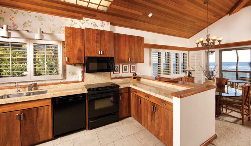 cabinet Kitchen property stove appliance home cabinetry hardwood cottage cuisine classique farmhouse counter countertop oven wood flooring stainless steel Island kitchen appliance