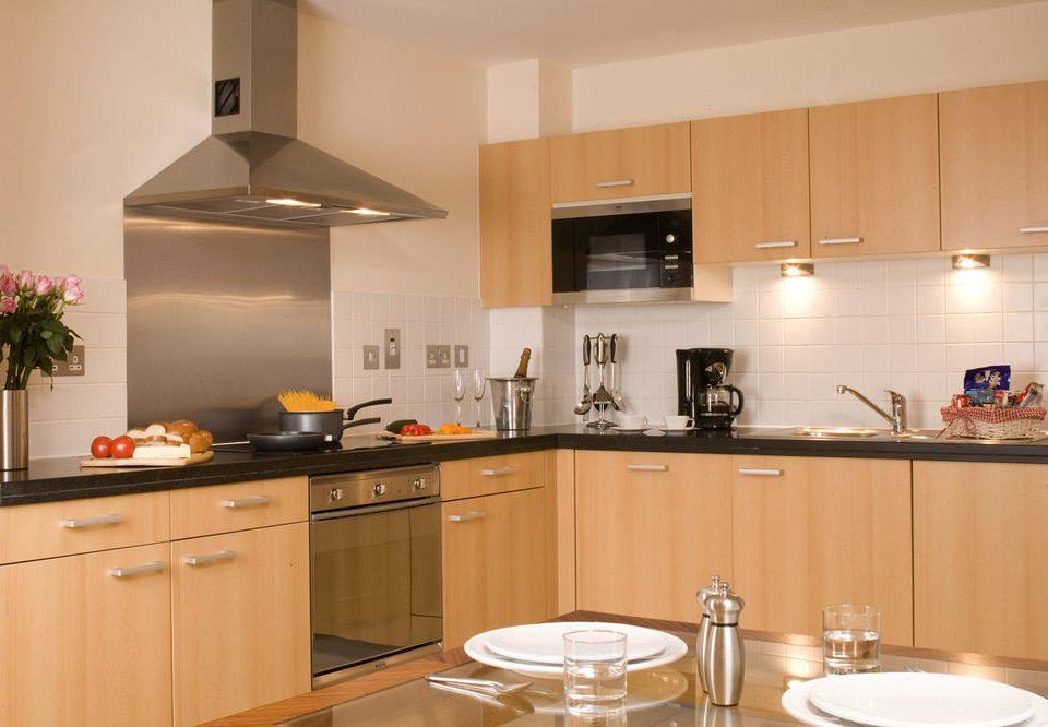cabinet Kitchen property cabinetry cuisine home hardwood cuisine classique countertop food cottage appliance counter kitchen appliance Island