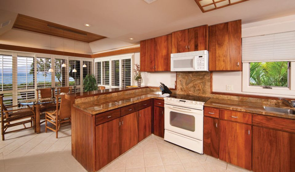 cabinet Kitchen property cabinetry home wooden hardwood cottage cuisine classique stove counter appliance farmhouse wood flooring countertop stainless kitchen appliance steel hard Island microwave