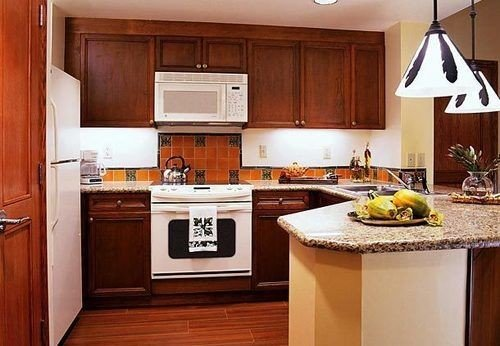 cabinet Kitchen property cabinetry countertop appliance home counter cottage wooden hardwood cuisine classique sink vehicle white stove Island kitchen appliance