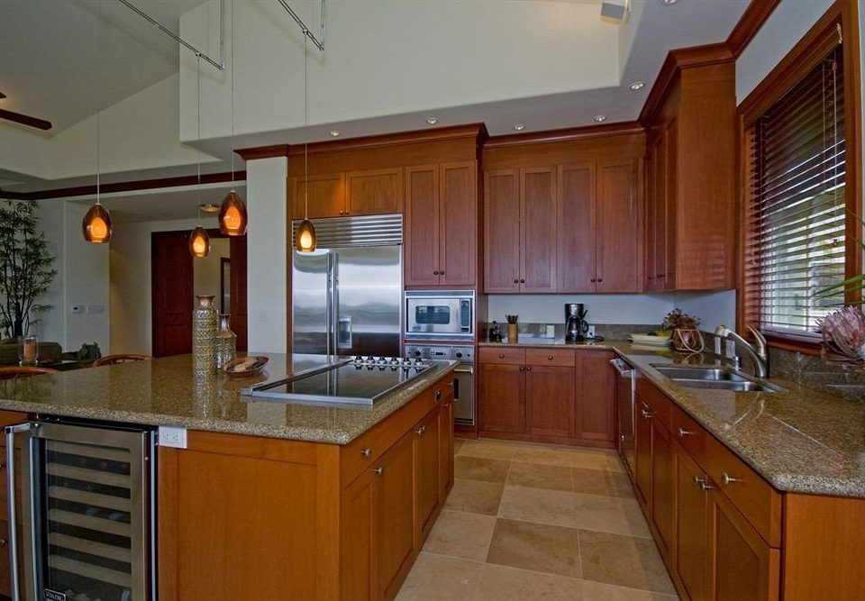 cabinet Kitchen property countertop cabinetry home house hardwood cuisine classique cottage counter mansion material appliance stainless steel Island