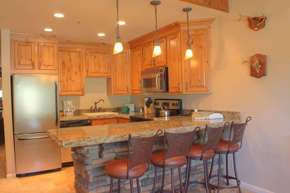 Kitchen cabinet property home cottage cabinetry hardwood cuisine classique farmhouse countertop appliance Island